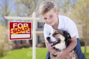 young-boy-his-dog-front-sold-sale-sign-house-happy-real-estate-32208032